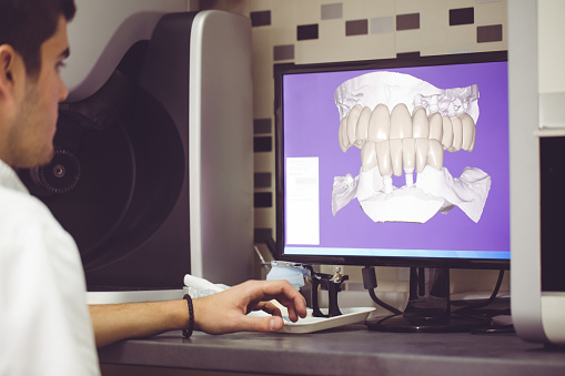A hygienist looking at a digital impression of the patient's teeth at Mid Valley Dental, in Menasha, WI